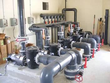 Pumps and plumbing installed by Robertson Commercial Pools, Inc